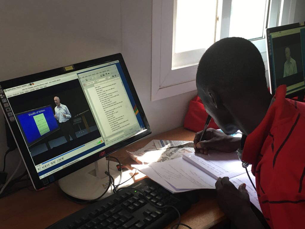 A refugee learner enrolled in the Lab's online history course, viewing one of the recorded lectures