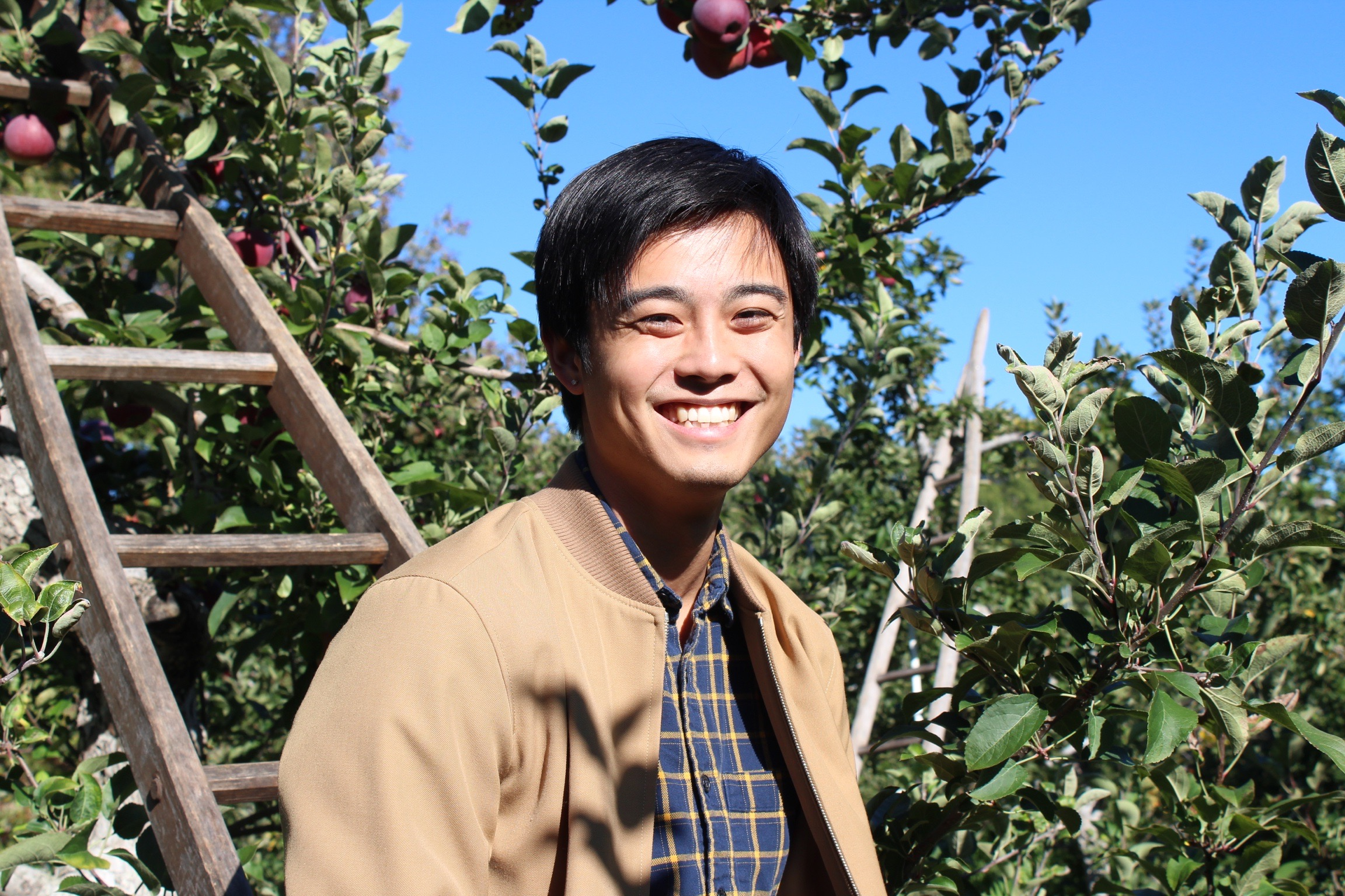 Ryan Low in an apple orchard