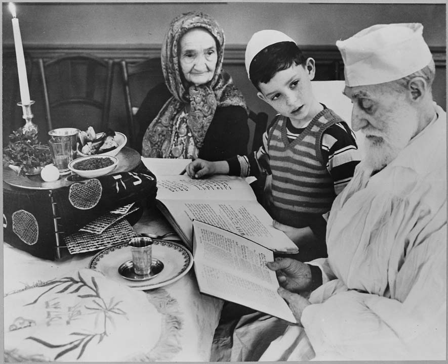 Photograph of a Young Jewish Boy with Elders at a Passover Ceremony, 04/16/1951. U.S. National Archives.