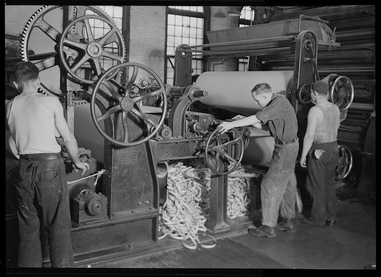 Rewinding paper from reel, 1936. U.S. National Archives.