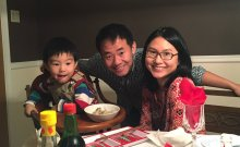 Xiyue Wang with his wife, Hua Qu, and son